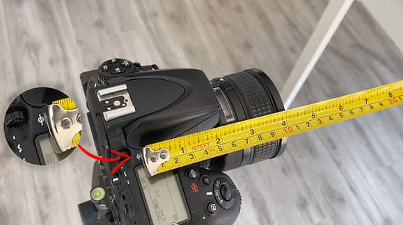 Marca que indica el Plano Focal de la cámara